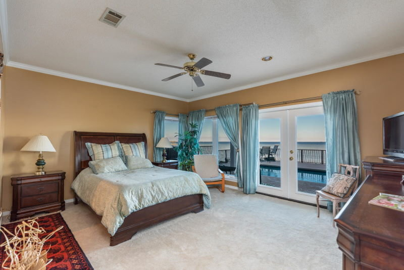 Master bedroom in Shalimar, FL waterfront home