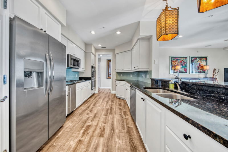Galley kitchen in Grand Harbor condo