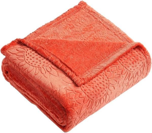 Plush throw accenting Living Coral